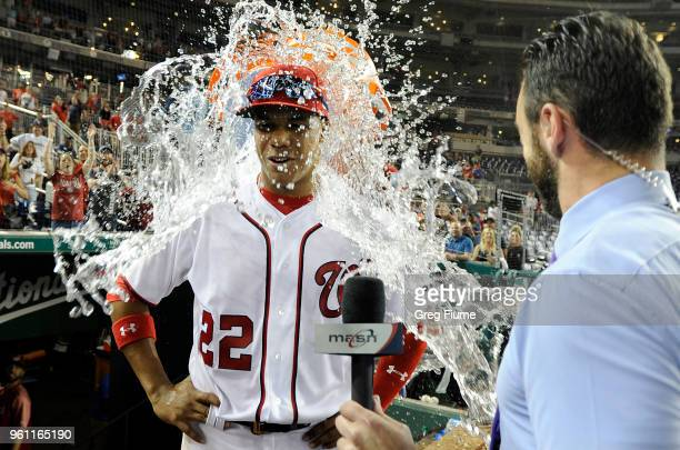 Juan Soto of the Washington Nationals is doused with water after a 102 victory against the San Diego Padres at Nationals Park on May 21 2018 in...