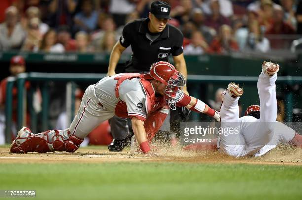 Juan Soto of the Washington Nationals is tagged out at home plate in the first inning by Andrew Knapp of the Philadelphia Phillies at Nationals Park...