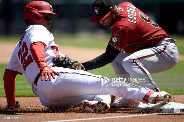 Juan Soto of the Washington Nationals is tagged out at third base in the first inning by Eduardo Escobar of the Arizona Diamondbacks at Nationals...