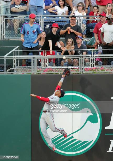Juan Soto of the Washington Nationals makes a catch up against the left field wall in the fourth inning during a game against the Philadelphia...