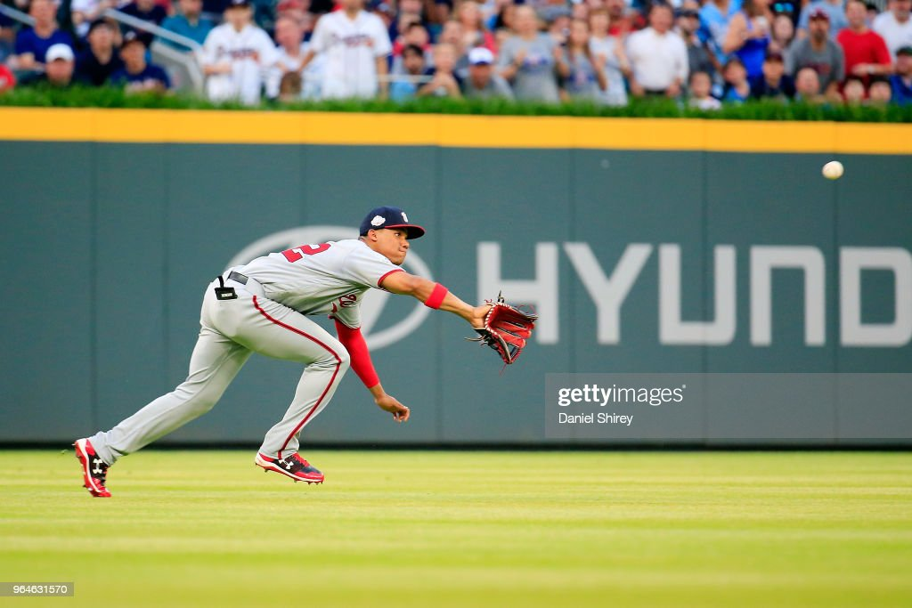 Juan Soto #22 of the Washington Nationals makes a diving catch during the second inning against the Atlanta Braves at SunTrust Park on May 31, 2018 in Atlanta, Georgia.