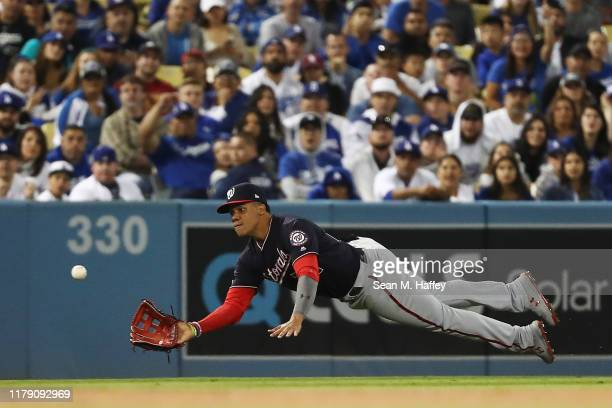 Juan Soto of the Washington Nationals makes a diving catch on a line ball hit by Clayton Kershaw of the Los Angeles Dodgers in the third inning in...