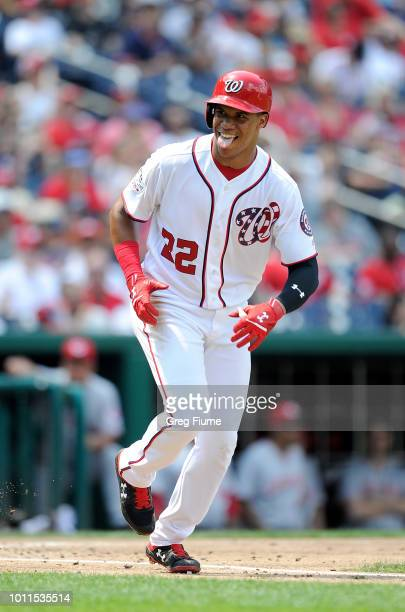 Juan Soto of the Washington Nationals reacts after drawing a walk in the third inning against the Cincinnati Reds at Nationals Park on August 5 2018...