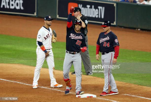 Juan Soto of the Washington Nationals reacts after hitting a single against the Washington Nationals during the eighth inning in Game One of the 2019...