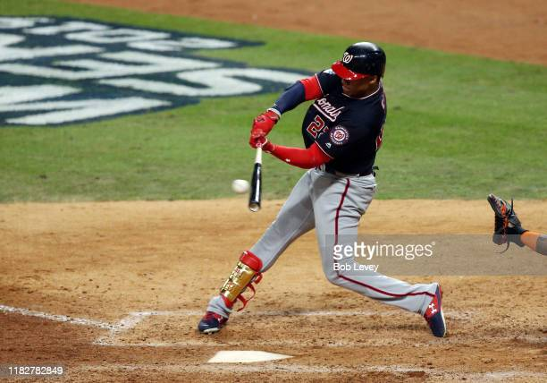 Juan Soto of the Washington Nationals singles against the Houston Astros during the eighth inning in Game One of the 2019 World Series at Minute Maid...
