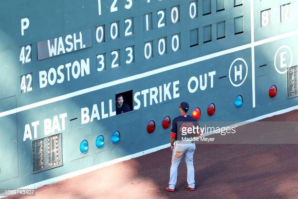 Juan Soto of the Washington Nationals talks with a scoreboard attendant working inside the Green Monster during the seventh inning of the game...