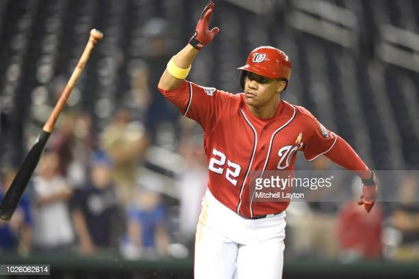 Juan Soto of the Washington Nationals throws the bat after singling in two runs in the eighth inning during a baseball game against the Milwaukee...
