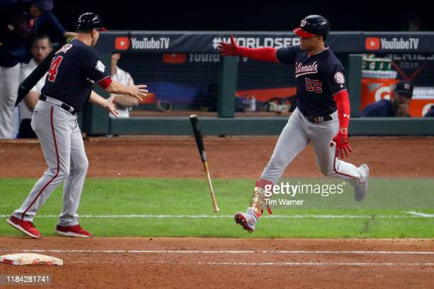 Juan Soto of the Washington Nationals tosses the bat toward first base coach Tim Bogar after hitting a solo home run against the Houston Astros...
