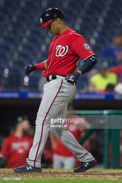 Juan Soto of the Washington Nationals touches home plate after hitting a solo home run in the top of the tenth inning against the Philadelphia...