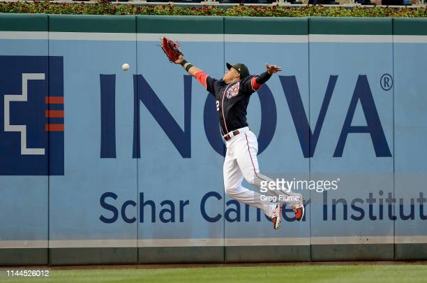 Juan Soto of the Washington Nationals tries to catch a double hit by Javier Baez of the Chicago Cubs in the first inning at Nationals Park on May 17...