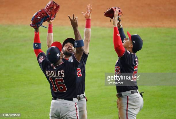 Juan Soto Victor Robles and Adam Eaton of the Washington Nationals celebrate their teams 54 win over the Houston Astros in Game One of the 2019 World...