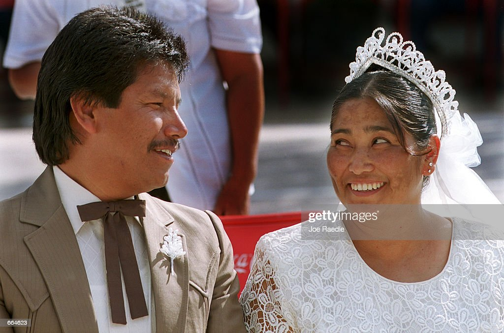 Juan Tejada Rodriguez and Marignacia Rodriquez Hernandez smile at each other during a wedding ceremony at a prison October 2, 2000 in Ciudad Juarez, Mexico. Mexican law allows for inmates to marry inside prison walls. 5 couples, one current inmate and four former inmates were married by their church pastor.