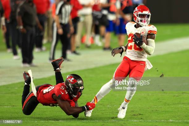 Juan Thornhill of the Kansas City Chiefs attempts to break a tackle from Lavonte David of the Tampa Bay Buccaneers during their game at Raymond James...