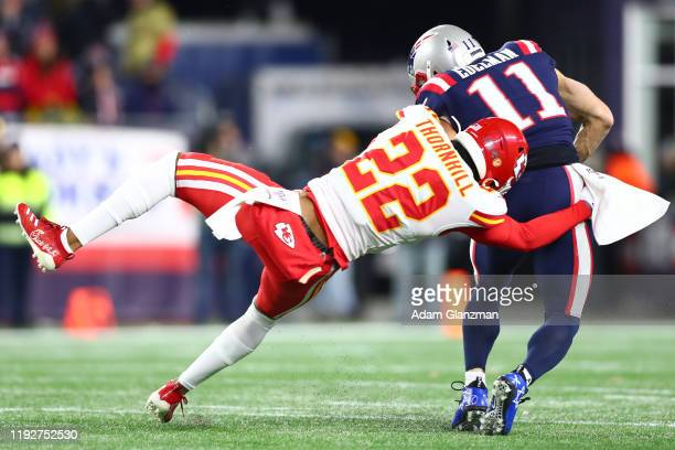 Juan Thornhill of the Kansas City Chiefs attempts to tackle Julian Edelman of the New England Patriots during the first half in the game at Gillette...