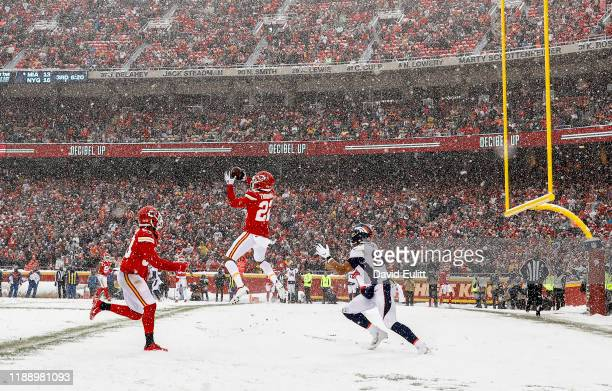 Juan Thornhill of the Kansas City Chiefs intercepts a Denver Broncos pass in the end zone during the third quarter at Arrowhead Stadium on December...