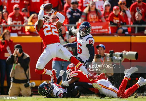 Juan Thornhill of the Kansas City Chiefs intercepts a pass intended for Will Fuller of the Houston Texans on fourth down in the second quarter at...