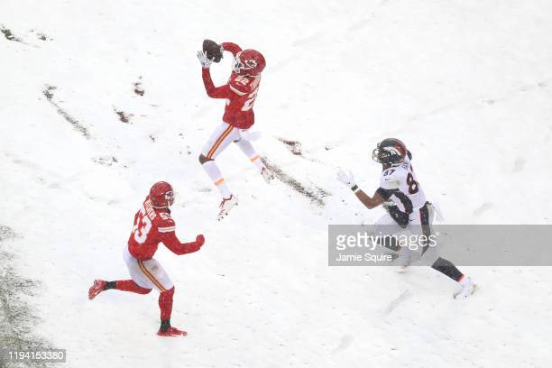 Juan Thornhill of the Kansas City Chiefs intercepts the ball intended for Noah Fant of the Denver Broncos in the game at Arrowhead Stadium on...