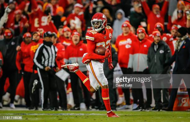 Juan Thornhill of the Kansas City Chiefs returns a second quarter interception for a touchdown against the Oakland Raiders at Arrowhead Stadium on...
