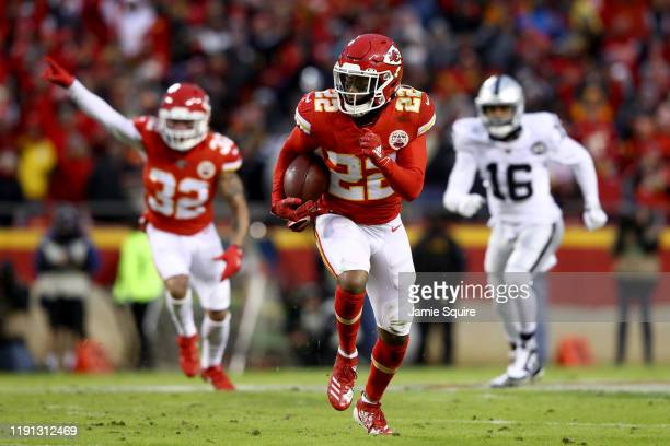 Juan Thornhill of the Kansas City Chiefs runs for the end zone to score a touchdown after intercepting a ball intended for Tyrell Williams of the...