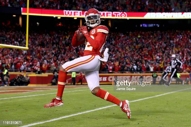 Juan Thornhill of the Kansas City Chiefs scores a touchdown after intercepting a ball intended for Tyrell Williams of the Oakland Raiders during the...
