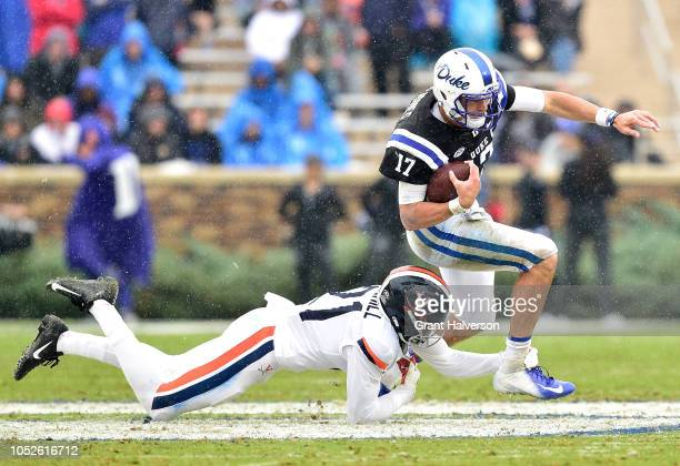 Juan Thornhill of the Virginia Cavaliers tackles Daniel Jones of the Duke Blue Devils during their game at Wallace Wade Stadium on October 20, 2018...
