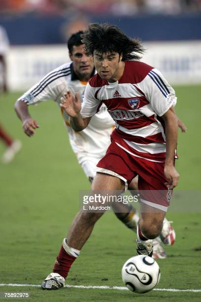 Juan Toja of FC Dallas dribbles the ball against Ante Jazic of the Los Angeles Galaxy during a SuperLiga match July 31, 2007 at Pizza Hut Park in...