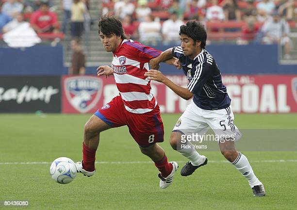 Juan Toja of FC Dallas takes control of the ball from Paulo Nagamura of the Chivas USA as seen during the match between Chivas USA and FC Dallas at...