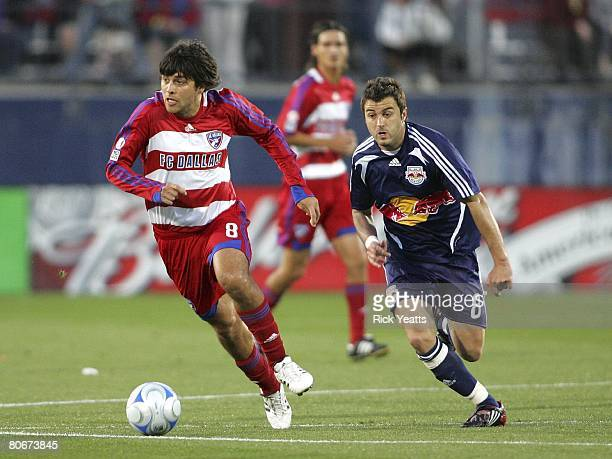 Juan Toja of FC Dallas takes the ball down field against the New York Red Bulls defense on April 12, 2008 at Pizza Hut Park in Frisco, Texas.