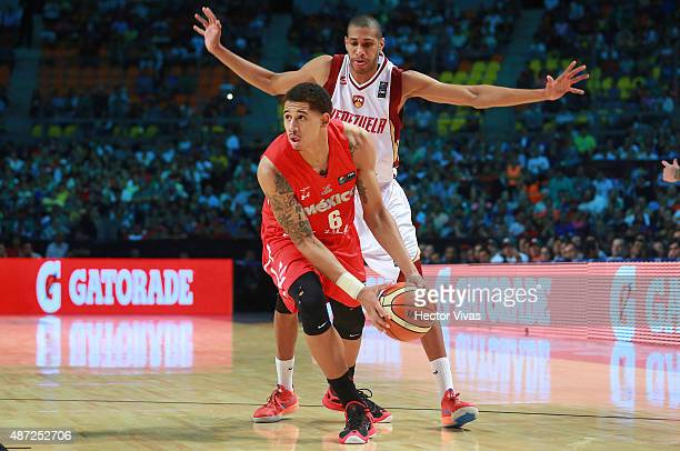 Juan Toscano handles the ball against Javinger Vargas of Venezuela during a second stage match between Venezuela and Mexico as part of the 2015 FIBA...