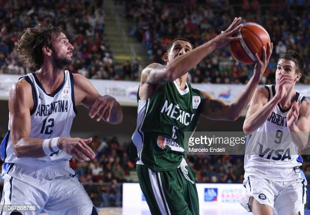 Juan Toscano of Mexico drives against Marcos Delia of Argentina during a match between Argentina and Mexico as part of FIBA Americas Qualifier for...