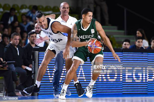 Juan Toscano of Mexico fights for the ball with Luis Scola of Argentina during a match between Argentina and Mexico as part of FIBA Americas...