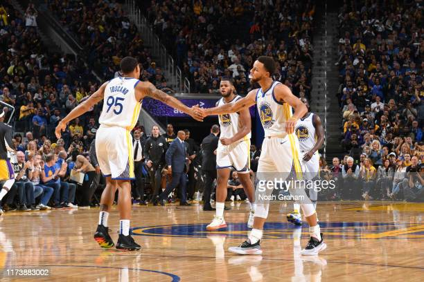 Juan ToscanoAnderson of the Golden State Warriors and Stephen Curry of the Golden State Warriors highfive during a preseason game against the Los...