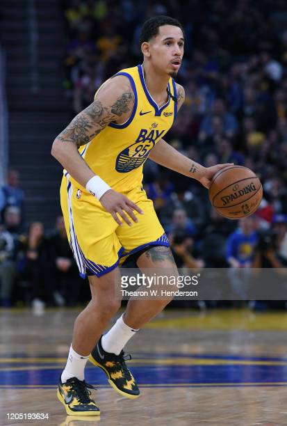 Juan ToscanoAnderson of the Golden State Warriors dribbles the ball against the Los Angeles Lakers during the second half of an NBA basketball game...