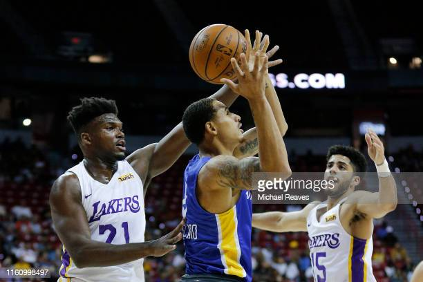Juan ToscanoAnderson of the Golden State Warriors grabs a rebound from Nick Perkins and Jordan Howard of the Los Angeles Lakers during the 2019 NBA...