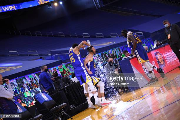 Juan Toscano-Anderson of the Golden State Warriors pours water on Stephen Curry after the game against the Denver Nuggets on April 12, 2021 at Chase...