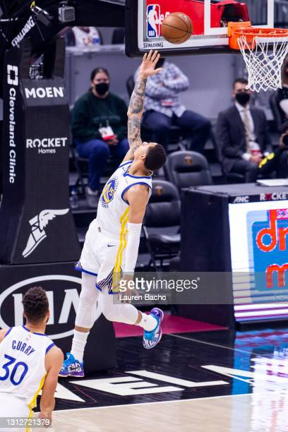 Juan Toscano-Anderson of the Golden State Warriors scores during the first quarter against the Cleveland Cavaliers at Rocket Mortgage Fieldhouse on...