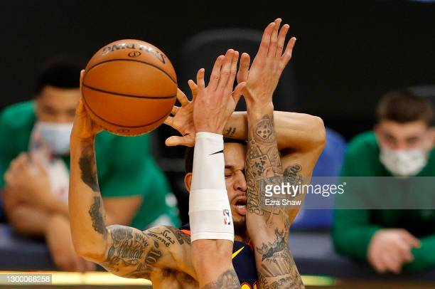Juan Toscano-Anderson of the Golden State Warriors tries to pass the ball around Daniel Theis of the Boston Celtics at Chase Center on February 02,...