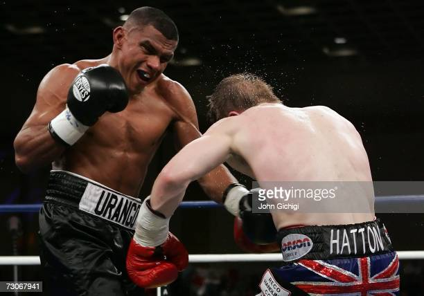 Juan Urango of Colombia throws a left and knocks back Ricky Hatton of England during their junior welterweight title fight on January 20, 2007 in the...