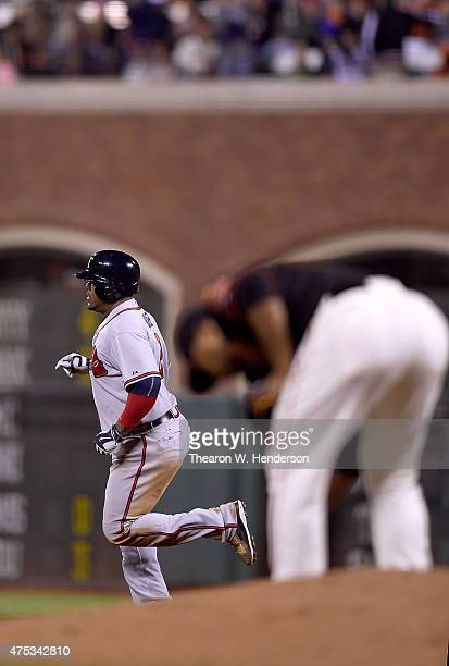 Juan Uribe of the Atlanta Braves trots around the bases after hitting a tworun homer off of Jean Machi of the San Francisco Giants in the top of the...