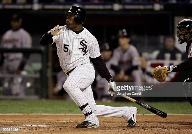 Juan Uribe of the Chicago White Sox hits an RBI double against the Houston Astros in the second inning during Game One of the 2005 Major League...