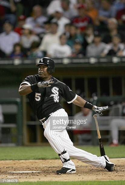Juan Uribe of the Chicago White Sox makes a hit during the game against the St Louis Cardinals on June 20 2006 at US Cellular Field in Chicago...