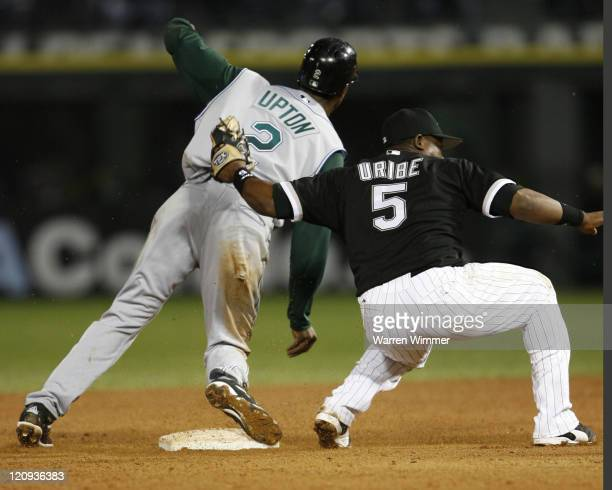 Juan Uribe of the Chicago White Sox tags a base stealing B J Upton during game action at U.S. Cellular Field, Chicago, Illinois on August 30, 2006....