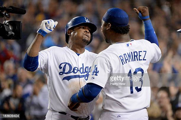 Juan Uribe of the Los Angeles Dodgers celebrates with Hanley Ramirez after Uribe hits a tworun home run in the eighth inning against the Atlanta...