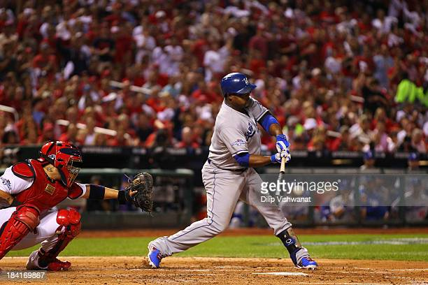 Juan Uribe of the Los Angeles Dodgers hits a two RBI single in the third inning against the St Louis Cardinals during Game One of the National League...