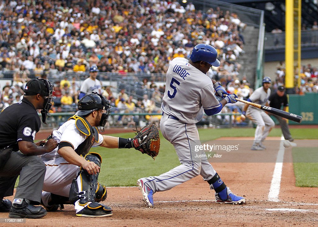 Juan Uribe #5 of the Los Angeles Dodgers hits an RBI single in the eleventh inning against the Pittsburgh Pirates during the game on June 15, 2013 at PNC Park in Pittsburgh, Pennsylvania. The Dodgers defeated the Pirates 5-3.