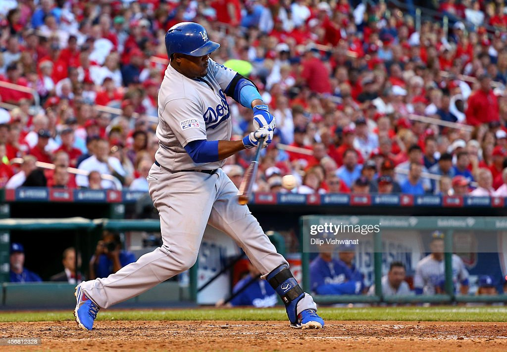 Juan Uribe #5 of the Los Angeles Dodgers hits an RBI single in the sixth inning against the St. Louis Cardinals in Game Four of the National League Divison Series at Busch Stadium on October 7, 2014 in St Louis, Missouri.