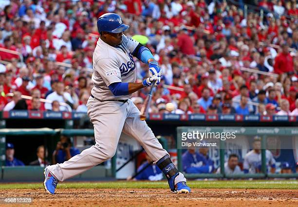 Juan Uribe of the Los Angeles Dodgers hits an RBI single in the sixth inning against the St Louis Cardinals in Game Four of the National League...