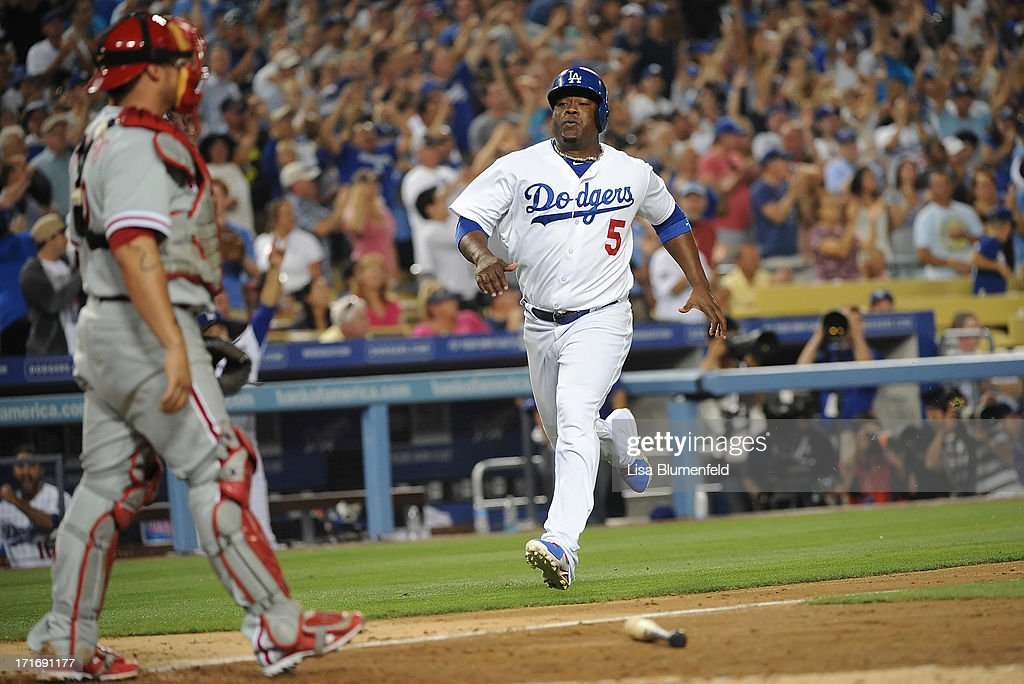 Juan Uribe #5 of the Los Angeles Dodgers runs home to score in the seventh inning against the Philadelphia Phillies at Dodger Stadium on June 27, 2013 in Los Angeles, California.