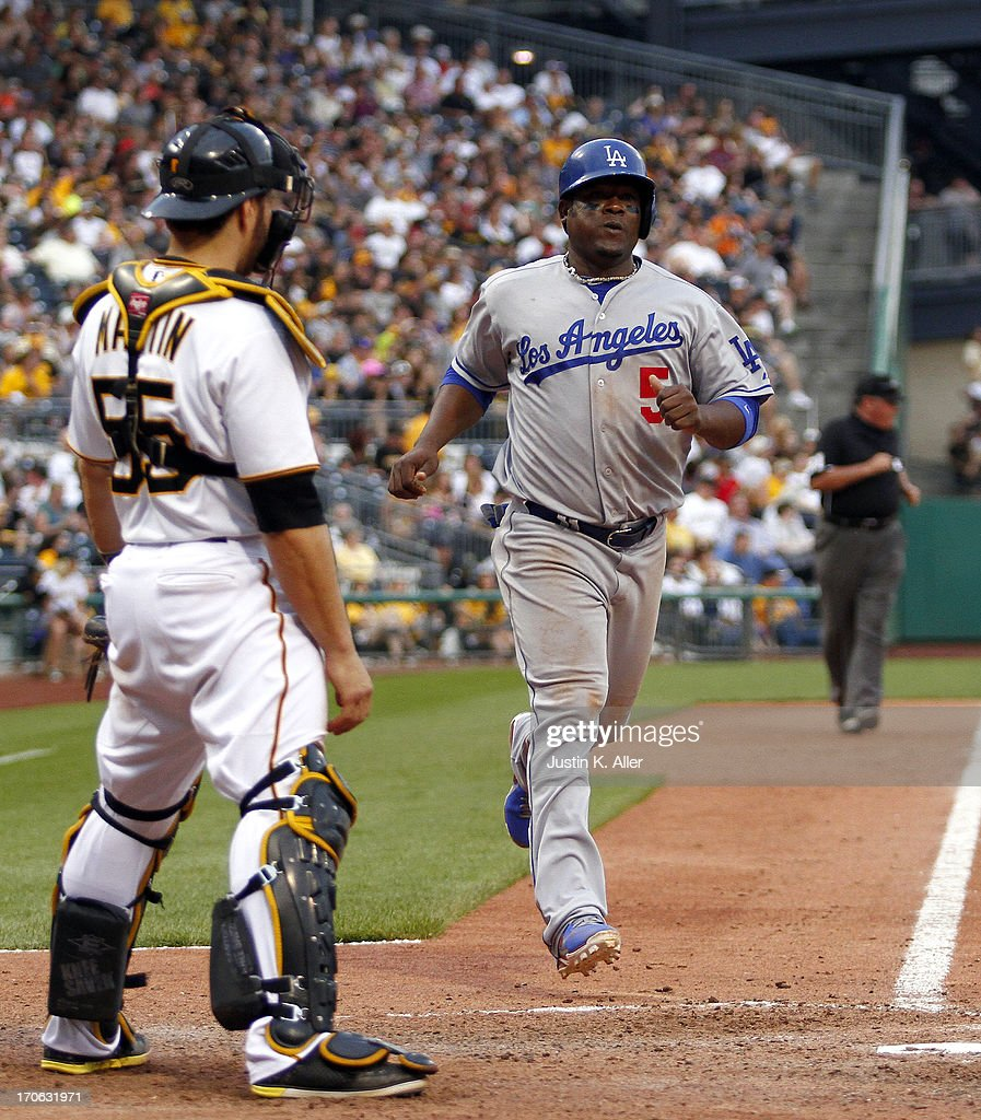 Juan Uribe #5 of the Los Angeles Dodgers scores on an RBI double in the eleventh inning against the Pittsburgh Pirates during the game on June 15, 2013 at PNC Park in Pittsburgh, Pennsylvania. The Dodgers defeated the Pirates 5-3.