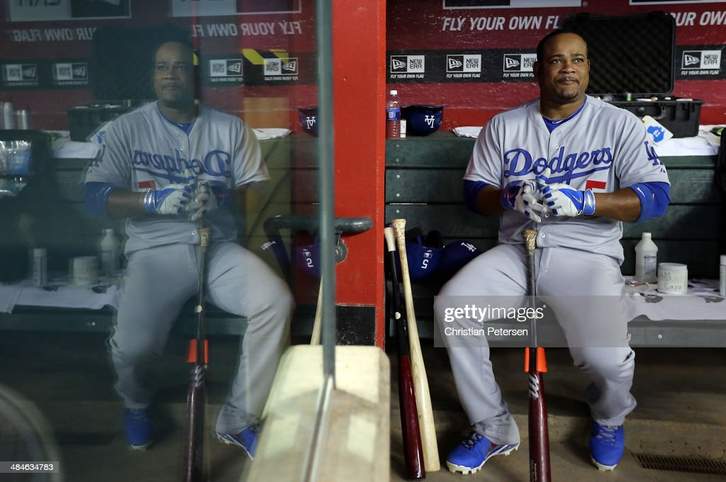 Juan Uribe #5 of the Los Angeles Dodgers sits in the dugout before the MLB game against the Arizona Diamondbacks at Chase Field on April 13, 2014 in Phoenix, Arizona.